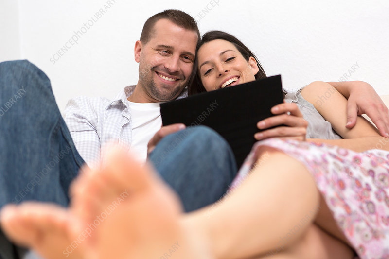 Couple looking at digital tablet together