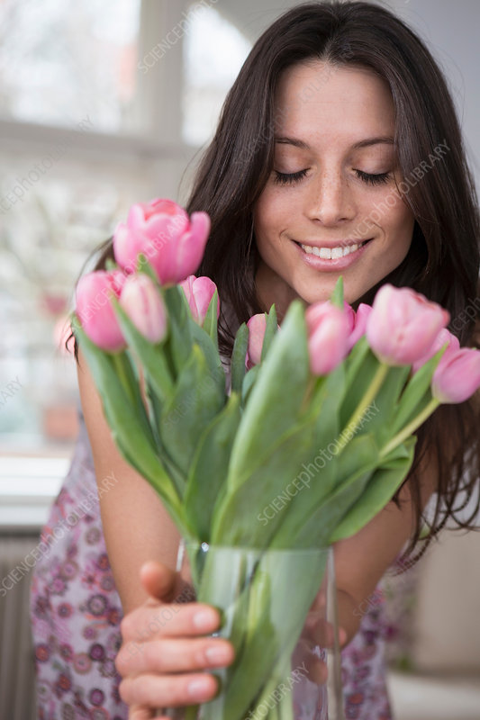 prices for haircuts holding vase of pink flowers stock image f008 4968 4968