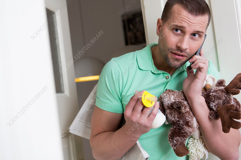 Man holding cuddly toy and pacifier