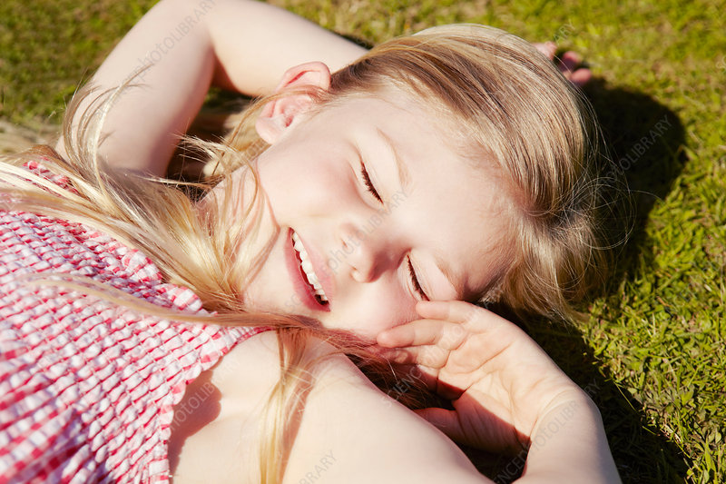 Child lying down on grass