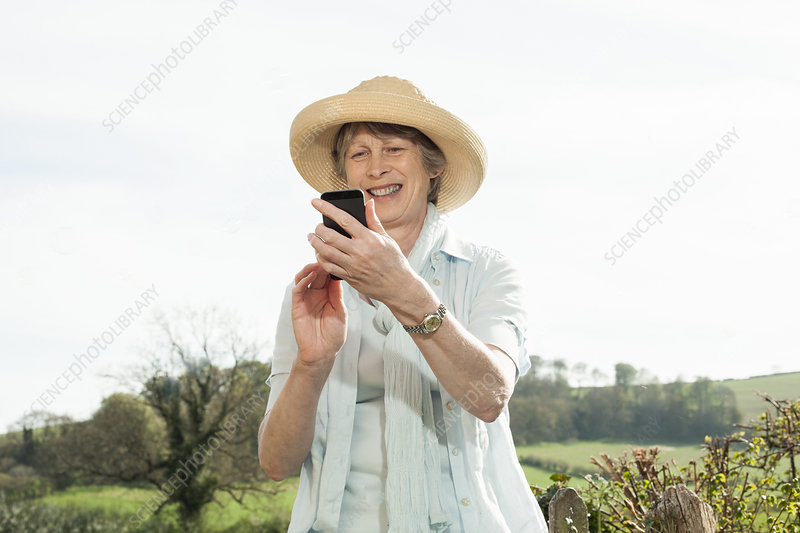 Woman smiling at message on mobile phone