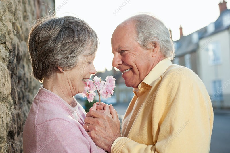 Man giving flower to wife