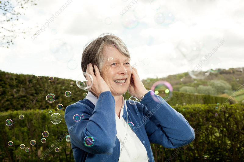 Woman laughing at bubbles