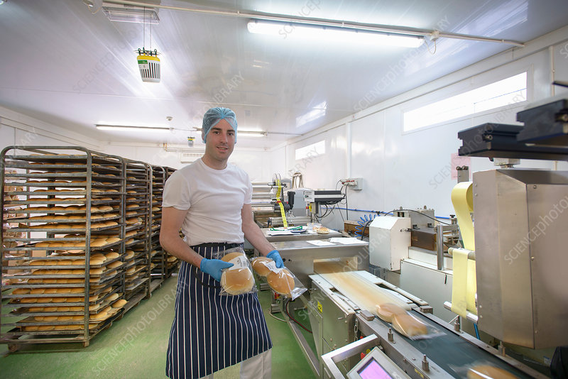 Baker on bread packing production line
