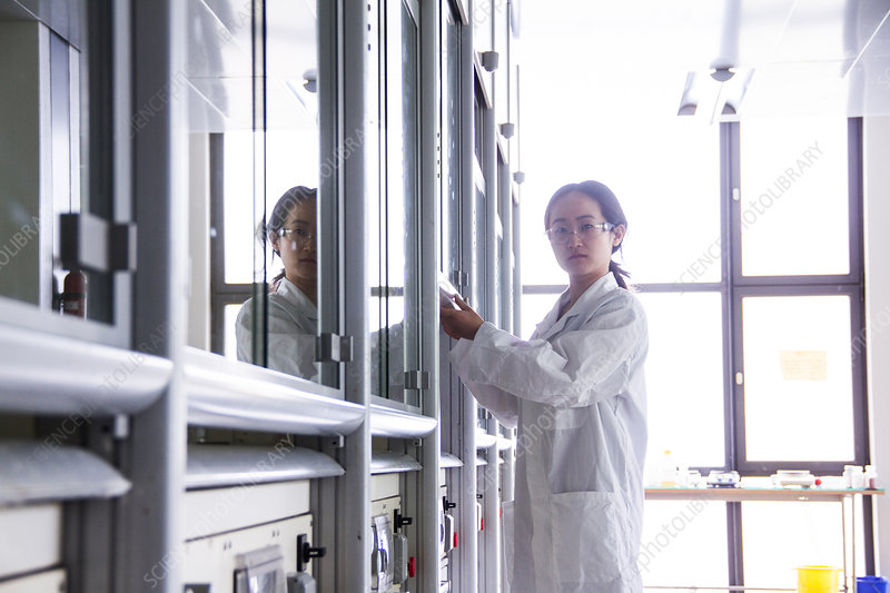 Female scientist using lab machinery