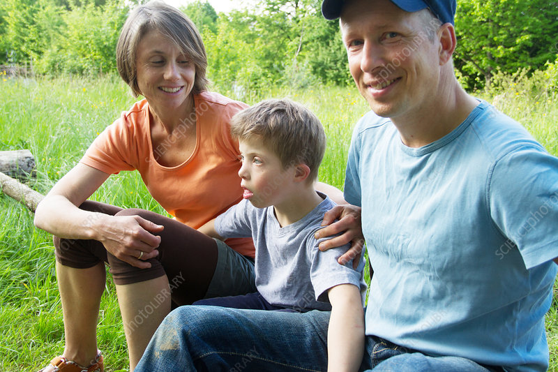 Portrait of parents and son outdoors