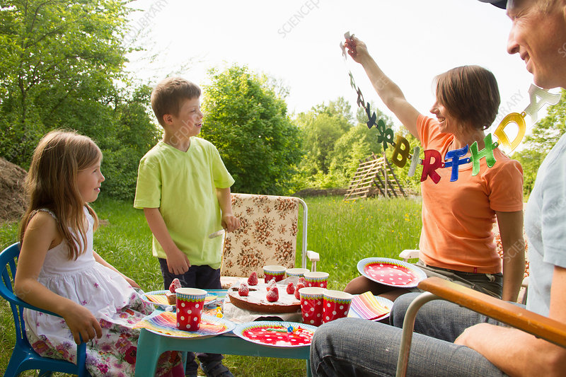 Family celebrating birthday outdoors