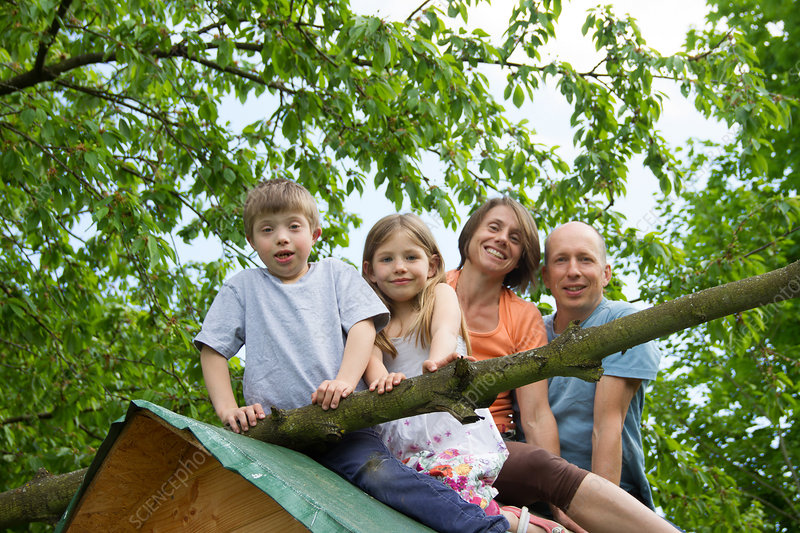 Family sitting on playhouse roof