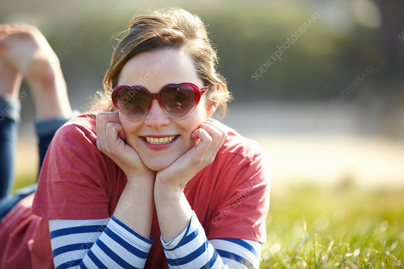 Woman wearing heart shape sunglasses