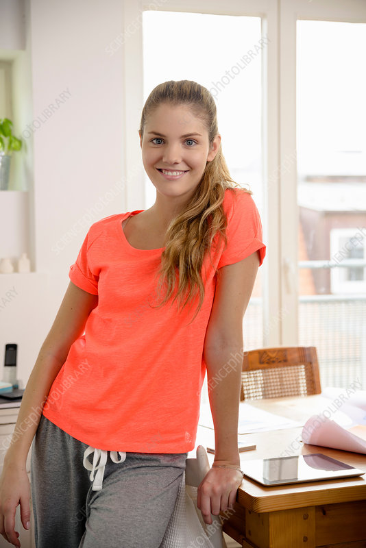 Woman in sports wear at home