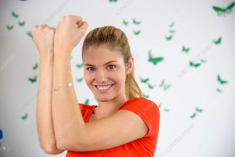Woman practicing arm exercise at home
