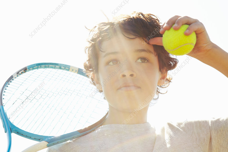 Boy with tennis racket and ball