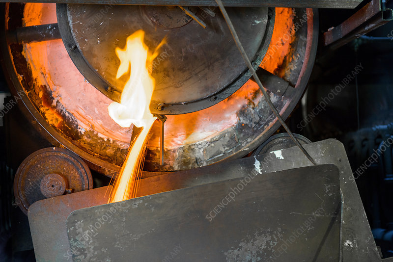 Close up of machinery and molten metal