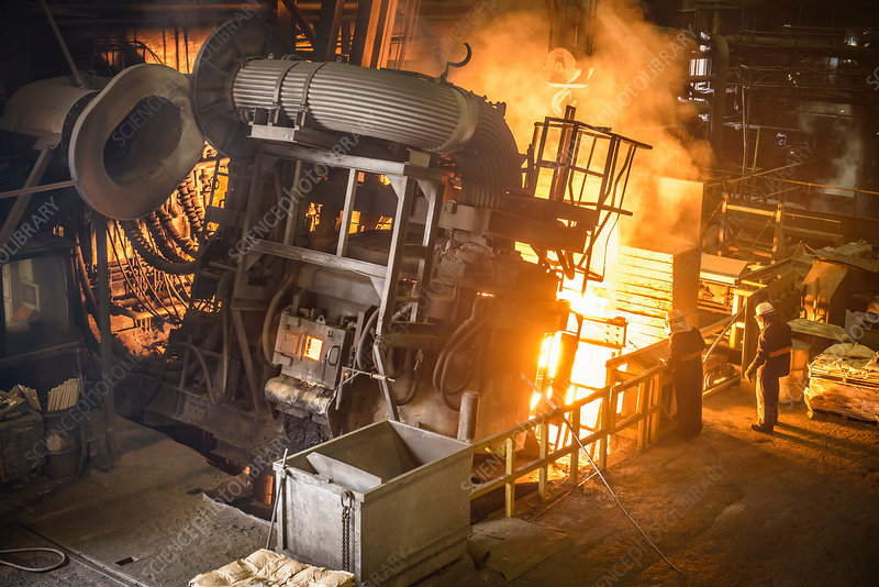 Workers and machinery in steel foundry