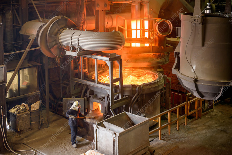 Elevated view of steel worker and furnace