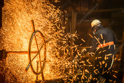 Steel worker amongst sparks