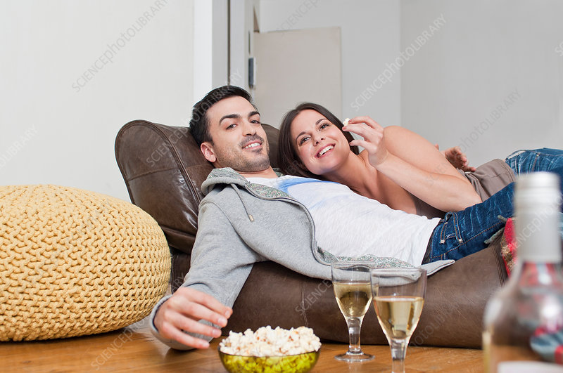Couple sharing wine and popcorn