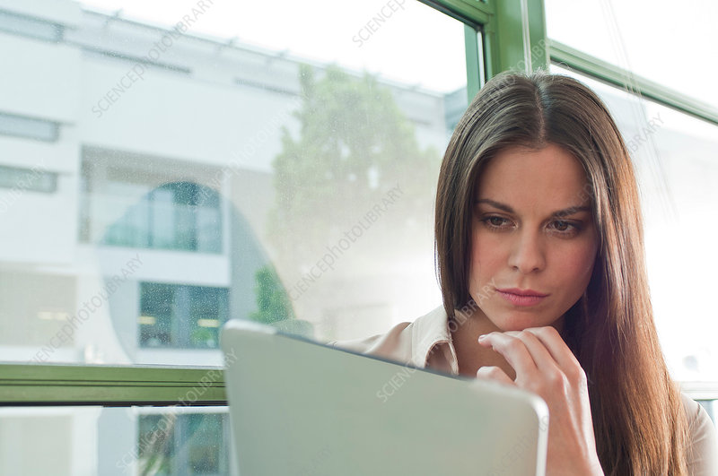 Woman looking at digital tablet