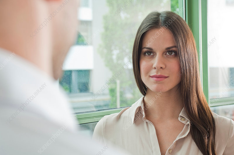 Office worker face to face with colleague