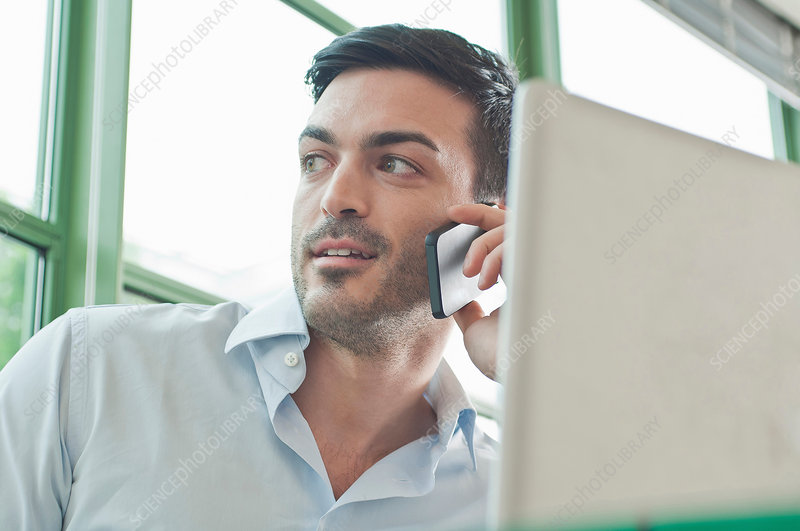 Office worker talking on mobile phone
