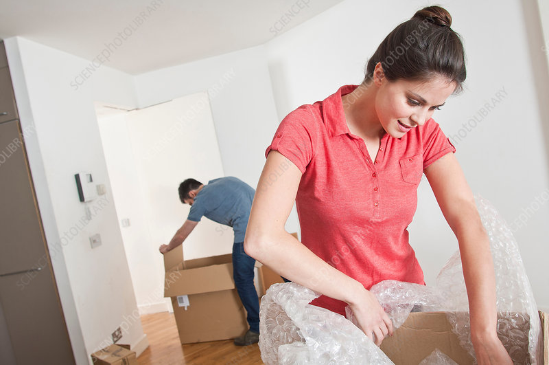 Young couple moving and unpacking
