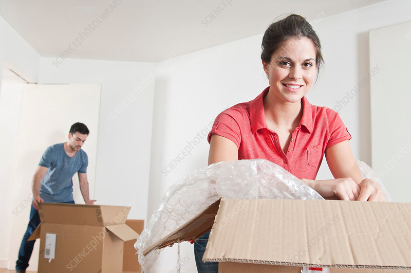 Young couple unpacking cardboard boxes