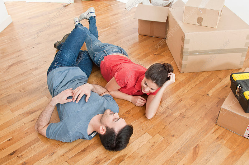 Couple on floor amongst cardboard boxes