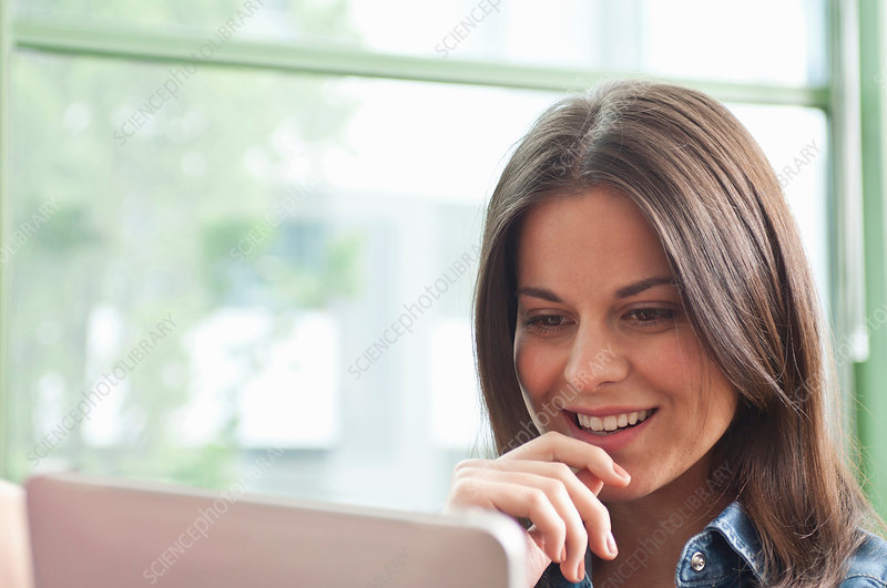 Young woman looking at digital tablet