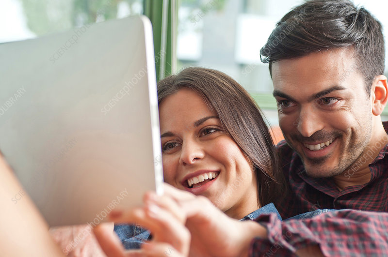 Young couple looking at digital tablet