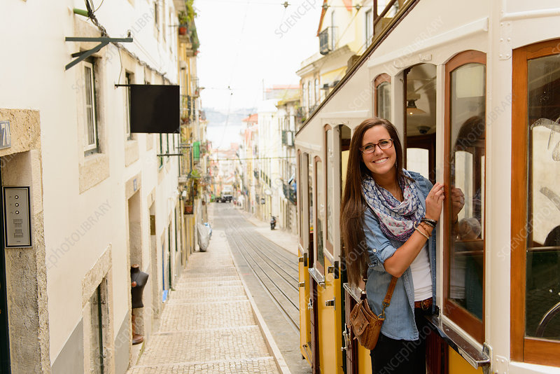 Tourist riding tram in Lisbon, Portugal