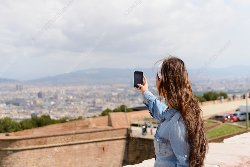 Tourist photographing view of Barcelona