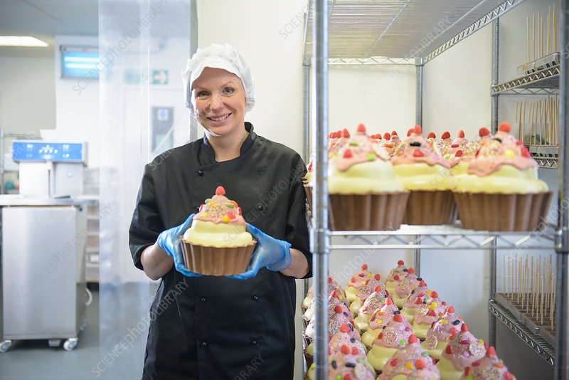 Chocolatier with giant chocolate cupcake
