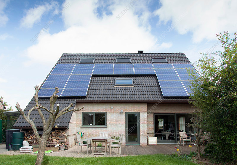 Bungalow with solar panels on roof