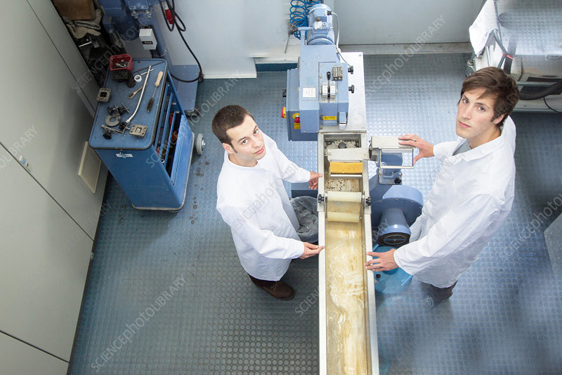 Scientists in technical laboratory