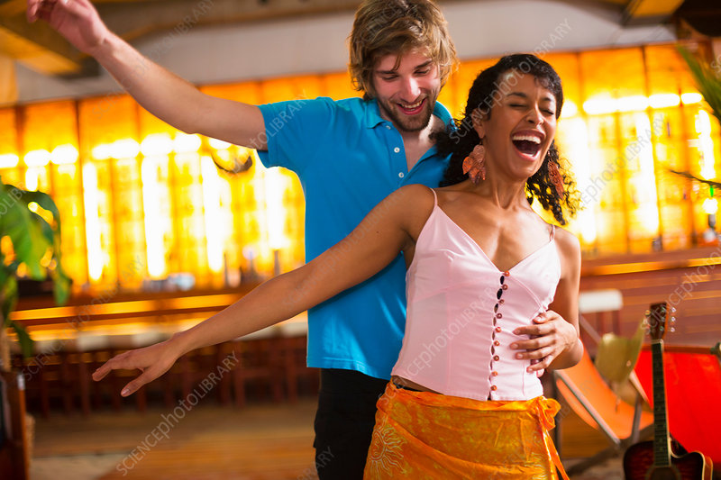 Couple dancing in bar