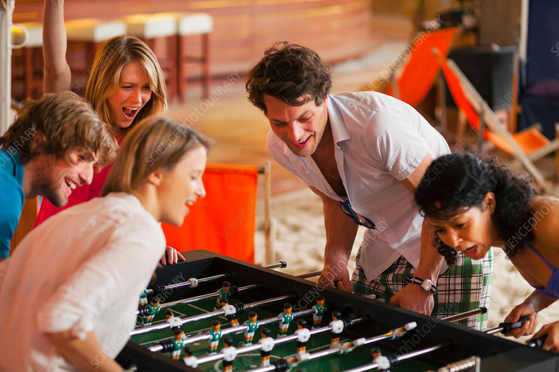 Friends having fun playing table football