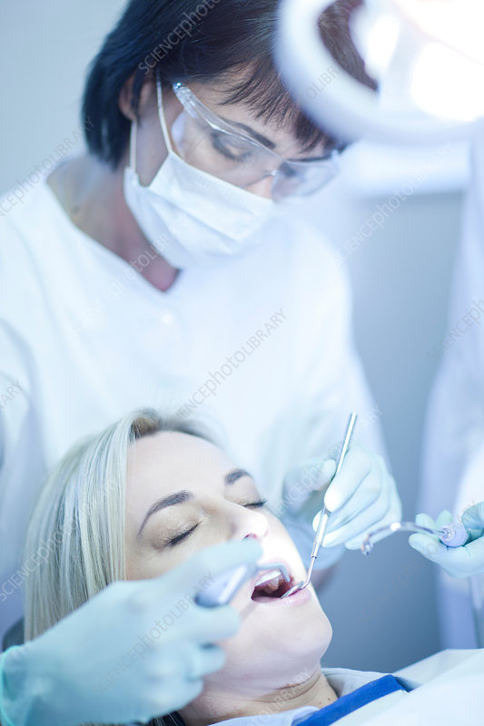 Dentist examining patients teeth