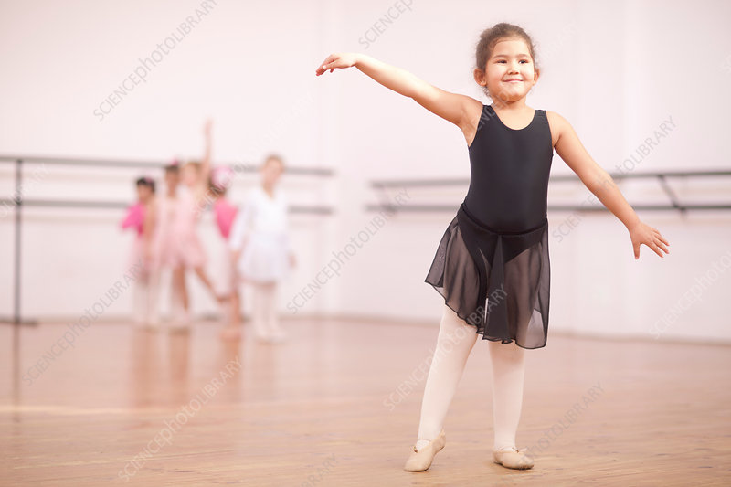 Young ballerina posing in dance studio