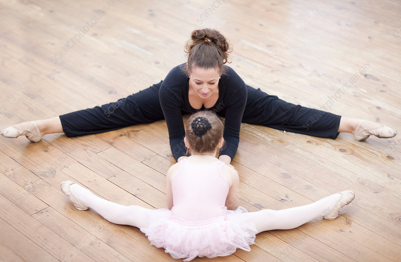 Teacher and ballerina practicing stretch