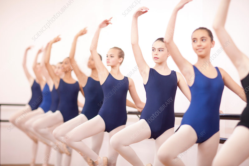 Ballerinas with arms outstretched