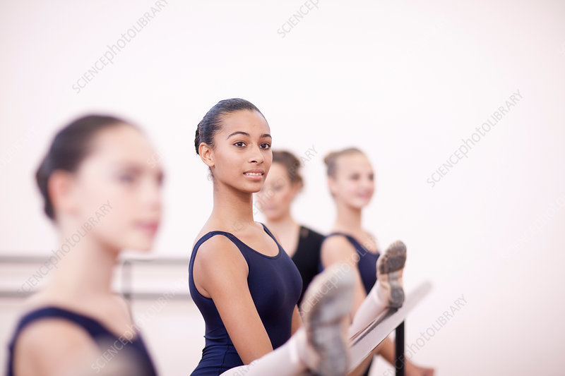 Teenage ballerinas practicing