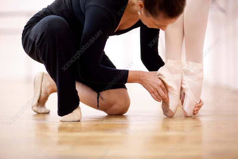 Teacher adjusting foot position