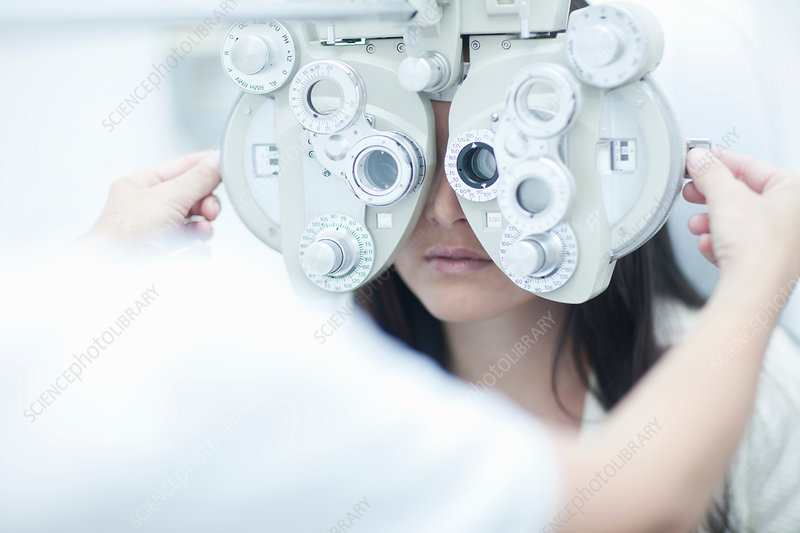 Optician testing patients sight