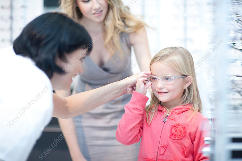 Girl choosing glasses