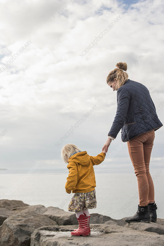 Mother and toddler on harbour wall