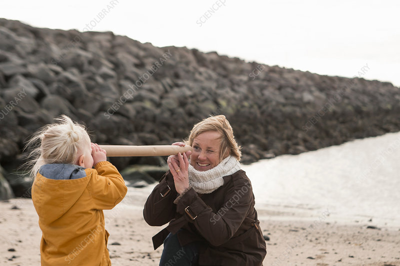 Grandmother and toddler at coast