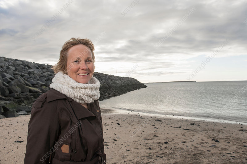 Portrait of mature woman at coast
