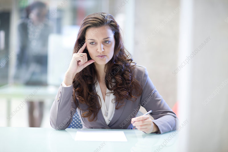 Young stressed businesswoman in office