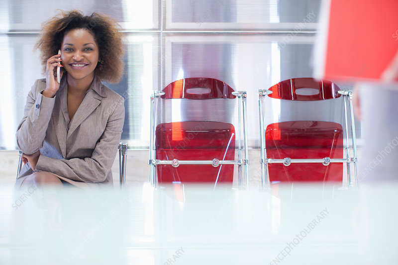 Young woman waiting in office