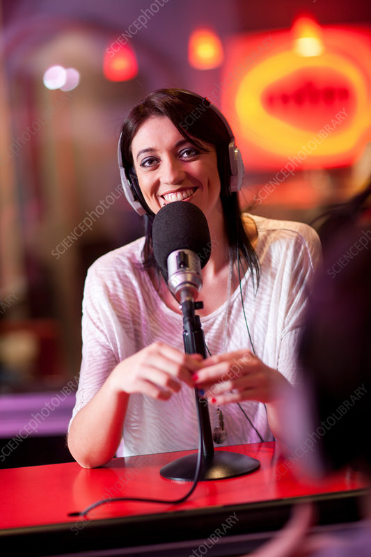 Woman broadcasting in recording studio